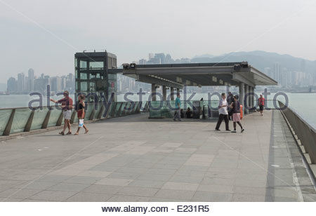 Kowloon looking over the Harbour to Hong Kong Island - Stock Photo