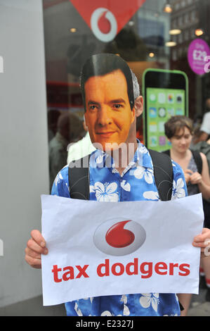 Oxford Street, London, UK. 14th June 2014. Protesters (one wearing a George Osborne mask) argue with police outside - Stock Photo