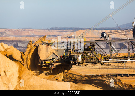 A giant Bucket Wheel Excavator at work in a lignite pit mine - Stock Photo