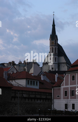 St Vitus' Church over the tiled roofs in downtown Cesky Krumlov in South Bohemia, Czech Republic. - Stock Photo