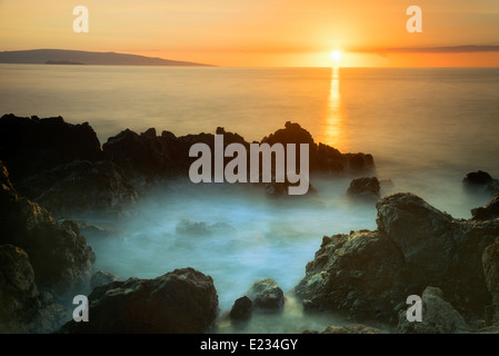Sunset and rocky coastline. Maui, Hawaii - Stock Photo