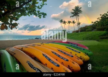 Kayaks on beach with rainbow. Maui, Hawaii - Stock Photo