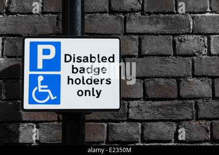 Parking for Disabled badge holders only warning sign for motorists, UK - Stock Photo
