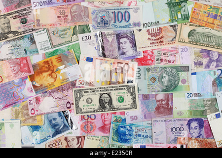 Paper money from all over the world forming a background - Stock Photo