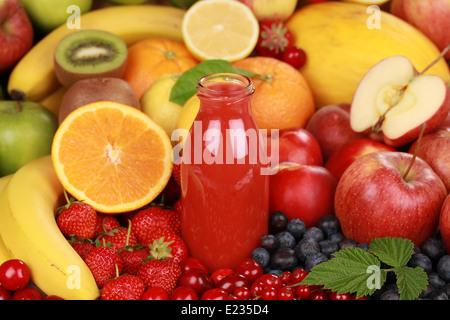 Freshly squeezed juice from red fruits in a bottle - Stock Photo