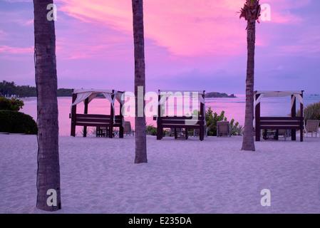 Beach chairs and sunrise at Four Seasons. Punta Mita Mexico. - Stock Photo