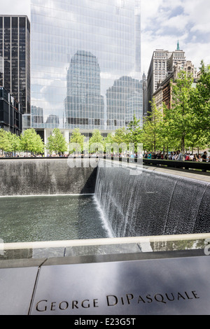 looking north across north pool World Trade Center memorial plaza which reflects footprint of destroyed north tower - Stock Photo