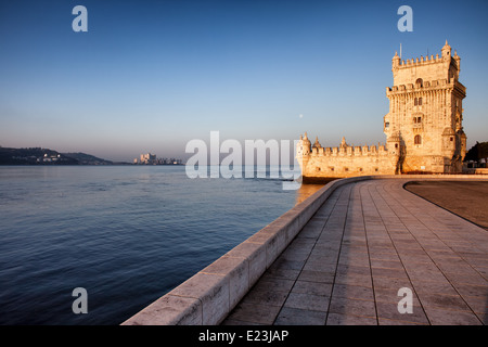 Belem Tower and promenade along Tagus river at sunrise in Lisbon, Portugal. - Stock Photo