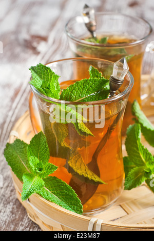 Traditional turkish tea with fresh mint. Selective focus. - Stock Photo