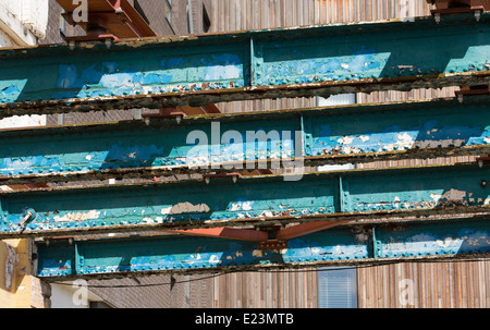 painted rusted flaking heavy metal load bearing girders on construction site - Stock Photo