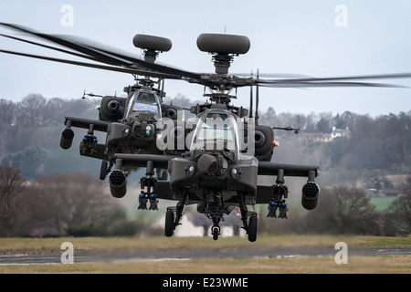 Two AAC AgustaWestland WAH-64D Apaches. - Stock Photo