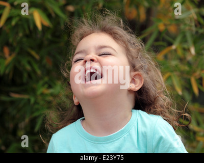 girl three years old laughing - Stock Photo