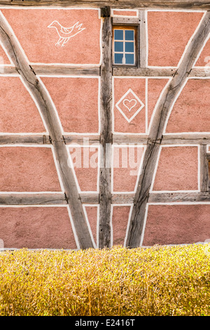 decorated facade of a half-timbered house at the écomusée d´alsace, ungersheim, alsace, france - Stock Photo