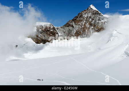 Figures of a mountaineering group high on Monte Rosa in the Swiss Alps - Stock Photo