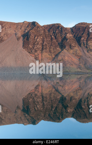 Wasdale screes reflected in Wast Water at dusk, English Lake District - Stock Photo