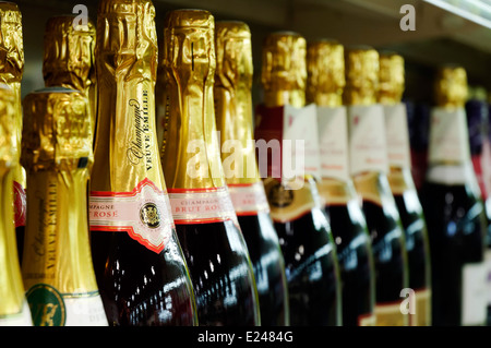 Bottles of Champagne on the shelves of a supermarket in France - Stock Photo