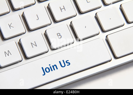 Photo of join us button on the white keyboard. - Stock Photo