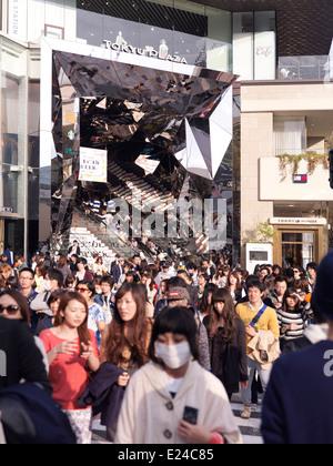 Young people exiting Tokyu Plaza Omotesando Harajuku shopping center in Tokyo, Japan. - Stock Photo
