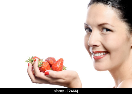 Smiling Woman with Strawberries in her Hand on white background. - Stock Photo