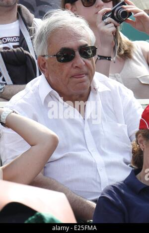 Former IMF chief Dominique Strauss-Kahn and his partner, Media Marketing Executive Myriam L'Aouffir watch the womens - Stock Photo