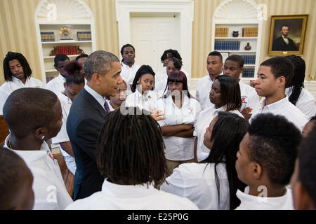 President Barack Obama talks with students from William R. Harper High School in Chicago in the Oval Office, June - Stock Photo