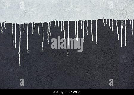 Gray paint drops on a dark gray wall - Stock Photo