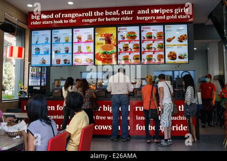 Inside a Burmese version of McDonald's fast food restaurant in the city centre of Yangon, Myamnar (Burma) - Stock Photo