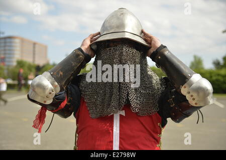 Garden City, New York, U.S. - June 14, 2014 - SAM AWRY is a USA Knights member putting on his helmet with chainmail - Stock Photo