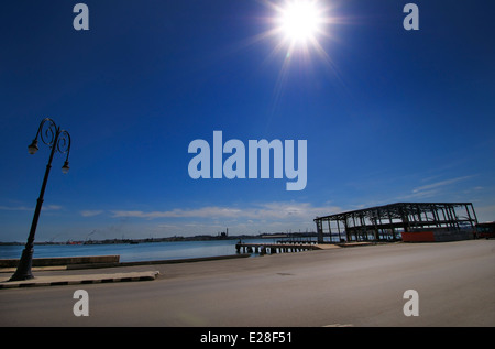 View of Old havana street with abandoned pier against blue sky - Stock Photo