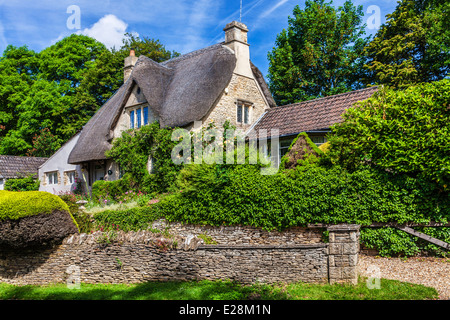 The picturesque thatched cottage in the Cotswold village of Castle Combe in Wiltshire. - Stock Photo