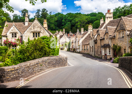 The main road through picturesque Cotswold village of Castle Combe in Wiltshire. - Stock Photo