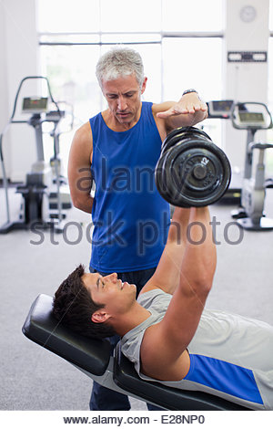 Men working out in gymnasium - Stock Photo