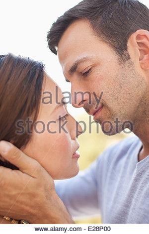 Couple kissing outdoors - Stock Photo