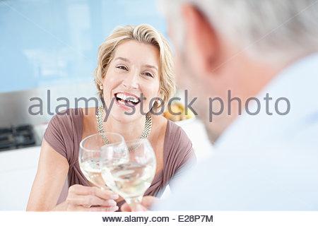 Mature couple drinking white wine - Stock Photo