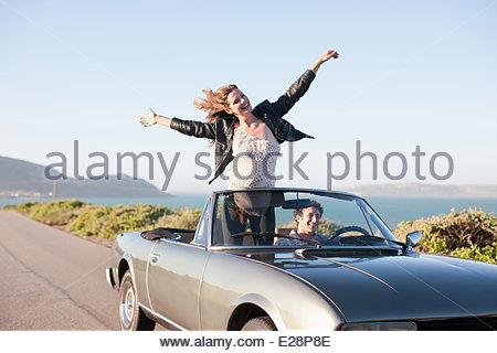 Couple riding in car  together - Stock Photo