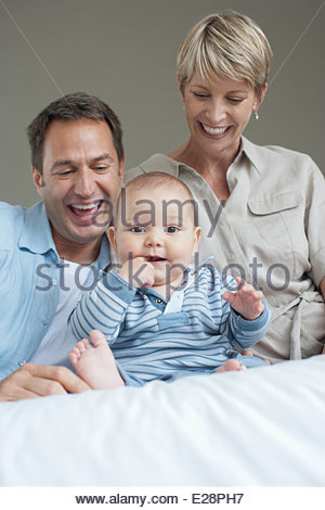 Mother, father and son smiling - Stock Photo