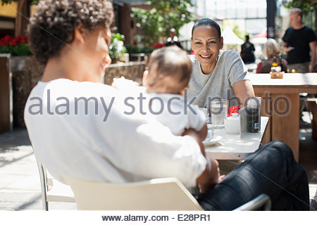Mother, son and friend at outdoor cafe - Stock Photo