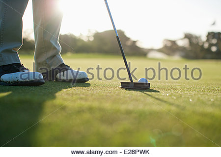 Man putting golf ball - Stock Photo