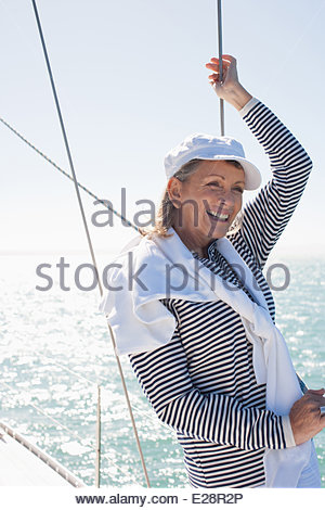 Woman standing on deck of boat - Stock Photo