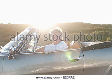Man driving convertible - Stock Photo