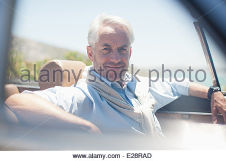 Man in convertible - Stock Photo