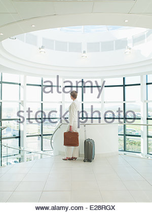 Businesswoman waiting to go on business trip - Stock Photo
