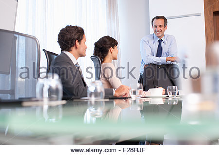 Business people working together in conference room - Stock Photo