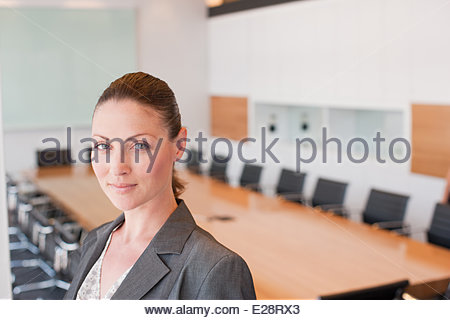 Businesswoman standing in office - Stock Photo