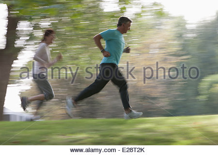 Couple jogging together outdoors - Stock Photo