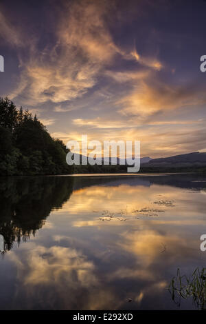 View of reservoir and distant hills at sunset, Penyfan, Taf Fechan Reservoir, Brecon Beacons N.P., Merthyr Tydfil, - Stock Photo