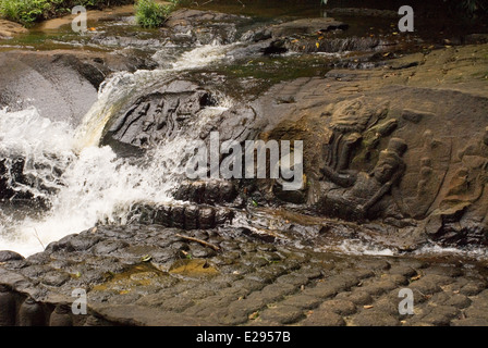 Deities carved river rocks. Kabal Spean. Kbal Spean is an ancient Hindu pilgrimage site in the jungle on the south - Stock Photo