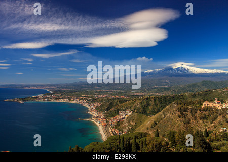 View of Mount Etna covered of snow and the coastline  around Taormina - Stock Photo