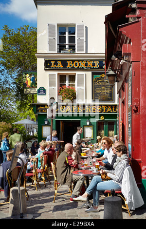 Turists in the Restaurant, Montmartre District, Paris, France - Stock Photo