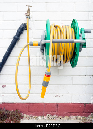 ... A Garden Hose Reel With Yellow Kink Resisting Hose Wall Mounted For  Convenient Deployment   Stock